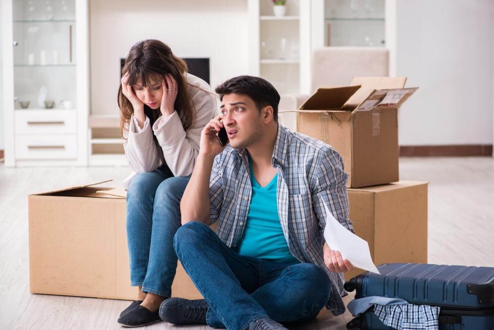 A young couple stressed after receiving a foreclosure notice.