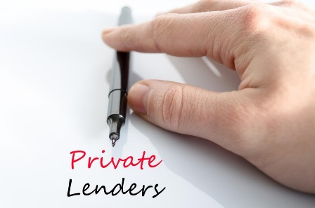 A person writing private lenders on a paper